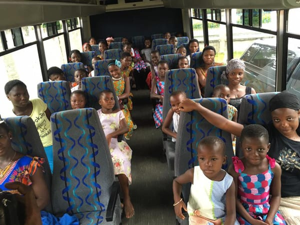Orphans Ready for Trip in Bus